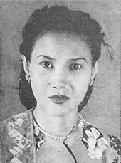 A black and white portrait of a woman.