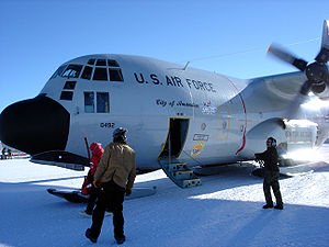 Jack F. Paulus Skiway - The South Pole cargo crew unloads passengers from an LC-130. In order to prevent lubricating oil, hydraulic fluids and fuel from freezing, the engines are kept running while the plane is on the ground.