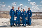 Soyuz MS-04 crew and backup at the Soyuz rocket monument behind the Cosmonaut Hotel.jpg