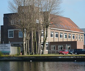 Anton Heyboer - South side of the former head office of Figee on the Spaarne river, which took a bomb during WWII above the draughtsmen's studio (the color difference can still be seen in the orange roof tiles)
