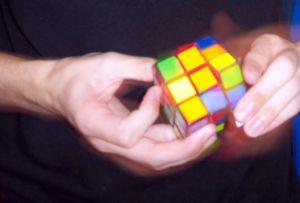 Speedcubing - A speedsolver completing a 3×3×3 Rubik's Cube.