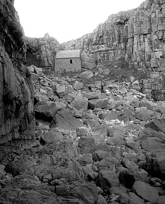 Saint Govan - St Govan's Chapel, Pembrokeshire built above the hermitage cell in the 14th century.