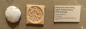 Tell Agrab - Stamp seal with Striding Figure Holding Batons, Drill Technique, Tell Agrab. Oriental Institute Museum, University of Chicago