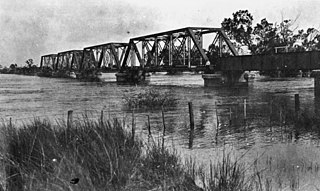 StateLibQld 1 15522 Railway bridge in Emerald during a flood, 1918.jpg