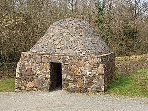 Clochán - A reconstruction of a square-shaped beehive hut at the Irish National heritage Park, County Wexford