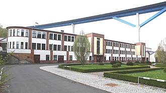 A building of the former Simson factory with A 73's Haseltal bridge in background Suhl-Simson1.jpg
