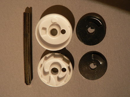 Mechanical counter wheels showing both sides. The bump on the wheel shown at the top engages the ratchet on the wheel below every turn. Teller (3).jpg