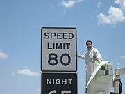 Speed Limit 80 mph (130 km/h) sign on a rural stretch of Interstate highway in western Texas. It is the highest posted speed limit in the U.S.