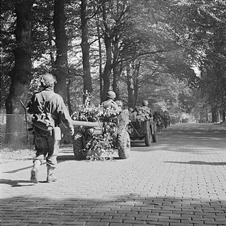 Battle of Arnhem - Men of the 2nd Battalion, South Staffordshire Regiment, of the 1st Airlanding Brigade, advance toward Arnhem, towing a 6-pounder anti-tank gun with them, 18 September.