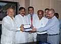 The CMD, Satluj Jal Vidyut Nigam Ltd., Shri H.K. Sharma along with his colleagues, presenting a cheque of Rs.60 crore as dividend to the Union Power Minister, Shri Sushilkumar Shinde, in New Delhi on August 13, 2009.jpg