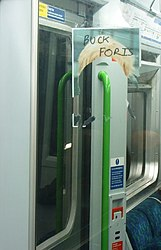 The Invisible Mayor - Going home on District Line (2540699936).jpg