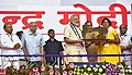 The Prime Minister, Shri Narendra Modi distributing the aids and assistive devices, at the Samajik Adhikarita Shivir in Race Course Ground, Rajkot, Gujarat (5).jpg