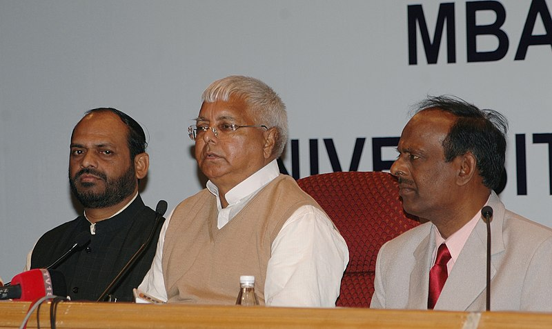 """File:The Union Minister for Railways Shri Lalu Prasad addressing a press conference after interacting with a group of MBA students from University of Texas and University of Virginia (USA) on the topic """" Turn Around of Indian.jpg"""