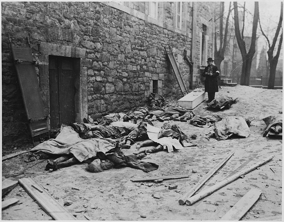 The bodies of Belgium men, women, and children, killed by the Nazis, await identification before burial. (As the... - NARA - 196543