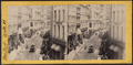 The bulls and bears in gold. William Street, in front of the Hole in the Wall, from Robert N. Dennis collection of stereoscopic views.png