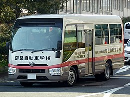 The frontview of Toyota COASTER LX (SKG-XZB70-ZRMEY) used by Nara Motor School.jpg