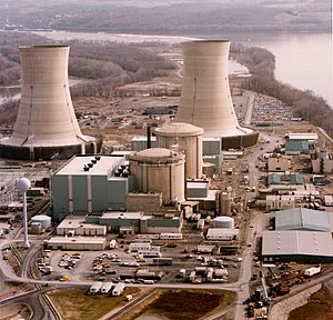 Aerial view of cooling towers and nuclear plant.