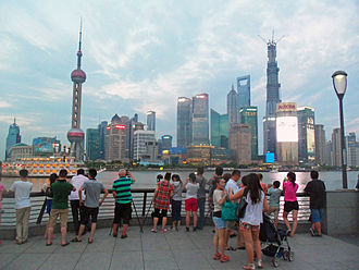 Tourism in China - Shanghai's skyline attracts tourists foreign and domestic to view it from the Bund
