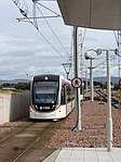 Tram arriving at Edinburgh Airport station (geograph 5475074).jpg