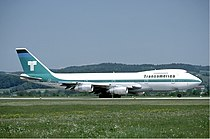 Transamerica Airlines Boeing 747 at Zurich Airport in May 1985.jpg