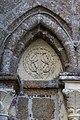 Tympan sur la façade de la collégiale Saint-Évroult, Mortain, France-4.jpg