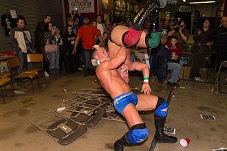 Tyson Dux - Dux suplexing Primo Scordino onto a stack of folding chairs.