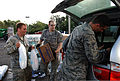 U.S. Airmen with the 259th Air Traffic Control Squadron, Louisiana National Guard (LANG) distribute food, water and ice to citizens in need of resources in New Orleans Sept 120901-A-SM895-018.jpg