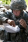 U.S. Army Pfc. Melanie L. Hawthorne, a line medic assigned to Headquarters and Headquarters Company, 508th Brigade Special Troops Battalion, 4th Brigade Combat Team, 82nd Airborne Division, calls in a nine-line 130627-A-PX354-035.jpg
