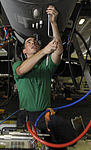 U.S. Navy Aviation Electrician's Mate Airman Chip J. Kasperczyk, assigned to Strike Fighter Squadron (VFA) 146, performs air data testing on an F-A-18C Hornet aircraft in the hangar bay aboard the aircraft 130619-N-PM023-176.jpg