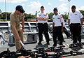 U.S. Navy Ensign Chris Engdahl explains details about the anchor chain to Navy Junior Reserve Officer Training Corps (JROTC) cadets from Druid Hills High School in Atlanta, Ga., onboard the Ticonderoga-class 090402-N-VM928-076.jpg