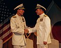 U.S. Navy Rear Adm. Terry B. Kraft, right, shakes hands with Rear Adm. Dan Cloyd during a change of command ceremony in Yokosuka, Japan, Aug. 23, 2013 130823-N-XG494-186.jpg