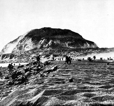 During the Battle of Iwo Jima, U.S. Marines land on the island, February 19, 1945. USMC-M-IwoJima-cvr.jpg