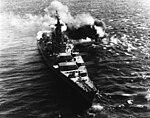 USS Iowa (BB-61) firing her 406 mm guns at North Korean coastal defenses in 1952.jpg
