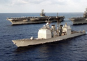 USS Port Royal (CG-73) steams alongside of USS Nimitz (CVN-68) and USS Independence (CV-62) off Japan on 25 September 1997 (6510644).jpg
