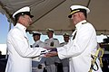 US Navy 020809-N-2810S-004 Master Chief Gerald Romero presents the Third Naval Construction Brigade flag to Rear Adm. Charles Kubic.jpg