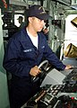 US Navy 021210-N-8029P-001 Seaman Apprentice Luke Simowitz maintains course while on watch as helmsman aboard the ship.jpg