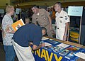 US Navy 031015-N-9362D-503 Navy Recruiters, Chief Machinist Mate Barry Meadors, left, and Dental Technician 2nd class Bobby Burns talks to high school students at a collage fair held at Kent State University.jpg