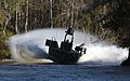 US Navy 031023-N-3953L-277 Members of Special Boat Team Two Two (SBT-22) practice narrow river beach extractions under hostile fire conditions.jpg