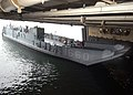 US Navy 040315-N-8606T-003 Landing Craft Utility (LCU) 1660 enters the amphibious assault ship USS Saipan's (LHA-2) well deck during recent certification in preparation for Saipan's upcoming scheduled deployment.jpg