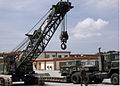 US Navy 040521-N-5704B-001 Equipment Operator 2nd Class Jessie Jernigan, drives a 50-ton lattice boom crawler crane.jpg