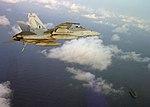 US Navy 040616-N-0000T-005 An F-A-18C Hornet soars through the clouds as it prepares to land aboard the Nimitz-class aircraft carrier USS Harry S. Truman (CVN 75) during flight operations.jpg