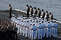 US Navy 040718-N-0535P-029 Sailors and Marines bow their heads in respect during a wreath laying ceremony held on the flight deck in honor of Capt. Franklin Hooks II.jpg