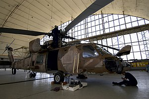 Aircraft maintenance checks - A United States Navy SH-60F Seahawk helicopter undergoing routine maintenance in 2005