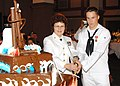 US Navy 061021-N-8825R-049 Chief Aerographer's Mate Victoria Baird and Yeoman Seaman Recruit Lance Adair cut the official cake of the 2006 Naval Air Station Meridian Navy Ball in the Riley Performing Arts Center of downtown Mer.jpg
