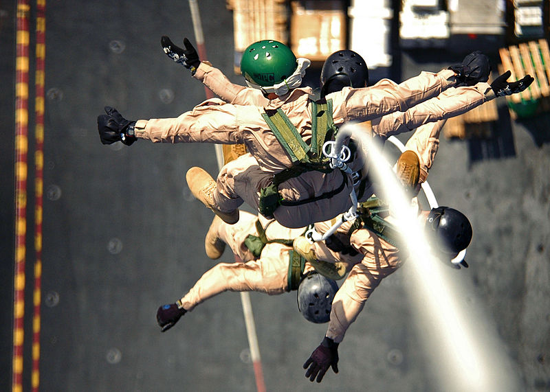 File:US Navy 061103-N-0490C-002 Explosive Ordnance Disposal Mobile Unit 6 (EODMU-6), Det. 16 conduct Special Purpose Insertion Extraction (SPIE) training from the flight deck of the Nimitz-class aircraft carrier USS Dwight D. Eisenh.jpg