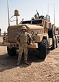 US Navy 070506-N-3560G-006 Equipment Operator 3rd Class Jacob Stahl, assigned to Naval Mobile Construction Battalion (NMCB) 4, Convoy Security Element, prepares to mount out with the Mine Resistant Ambush Protected (MRAP) Armor.jpg