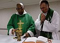 US Navy 070921-N-6278K-004 Father Joseph Harris, left, a Roman Catholic priest in Trinidad and Tobago, celebrates mass with Lt. Cmdr. Paul Evers.jpg