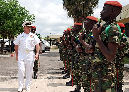 U.S. Navy commander is greeted by Gabonese Army US Navy 080107-N-4044H-049 Capt. John B. Nowell Jr., commodore, Africa Partnership Station (APS) is greeted by Gabonese Army as he arrives at a scheduled meeting with General Ntori Longo, chief of Gabonese Armed Services, about.jpg