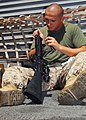 US Navy 080912-N-5148B-050 Hospital Corpsman 3rd Class Steven Lane cleans his M-16 rifle.jpg