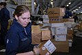 US Navy 080926-N-3610L-161 Machinist's Mate Fireman Ashley Bozeman gathers a stack of packages.jpg